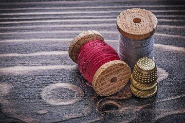 Vintage spools of thread thimbles