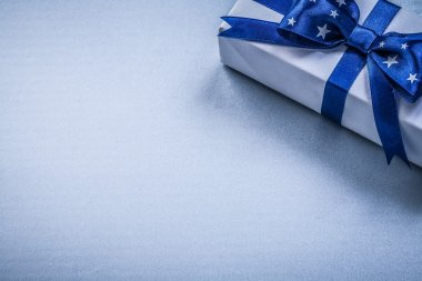 Gift box with present ribbon