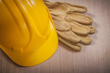 Leather safety gloves and hard hat