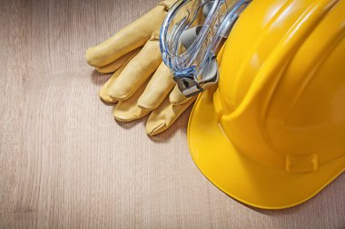 Safety helmet, protective gloves and goggles