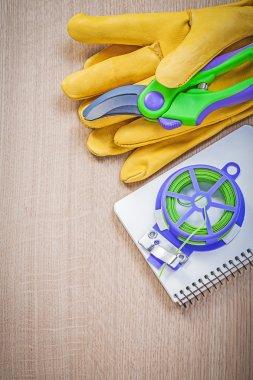 Gardening safety gloves secateurs garden tie wire copybook on wo