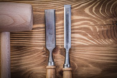 Wooden hammer and flat chisels