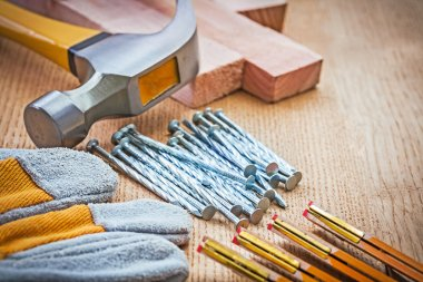 Close up view on carpentry tools on wooden board