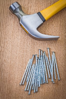 Stack of nails and claw hammer