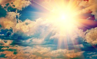 Beautiful sun in blue cloudy sky