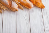 Baguettes and croissant, wheat ears