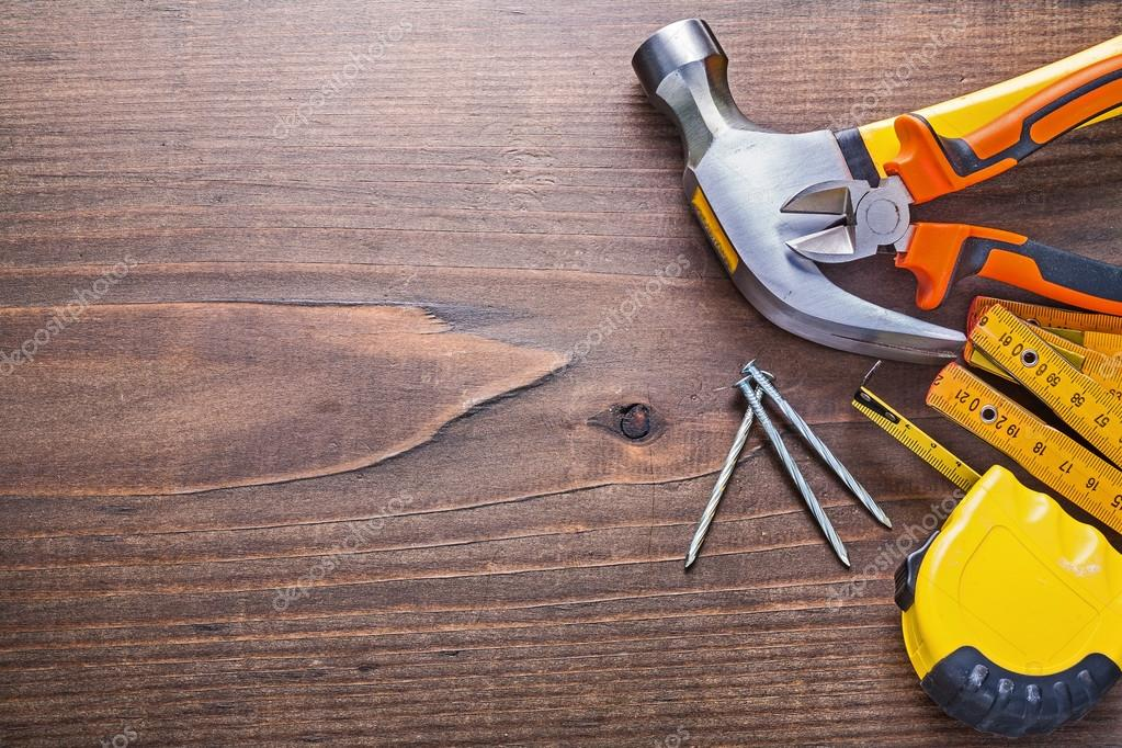 Construction tools on wooden background — Stock Photo ...