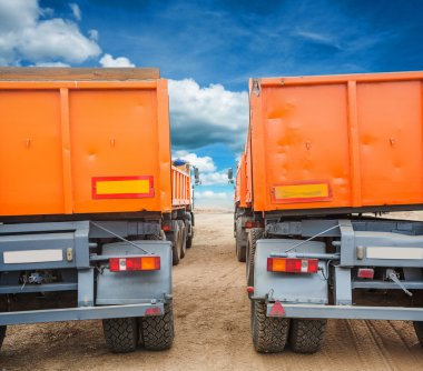 Through rows of tippers