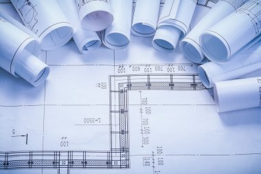 Rolled construction blueprints with organized copy space stock vector