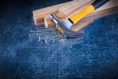 nails, claw hammer and wooden bricks