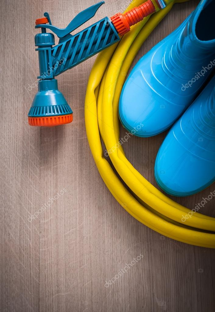 hose with spray nozzle and gum boots