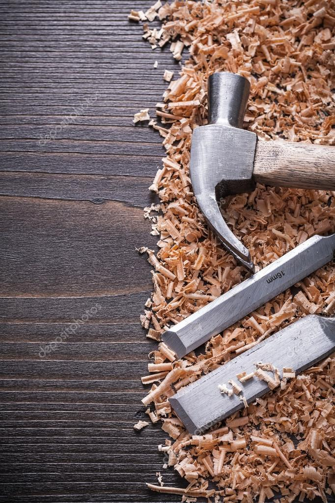 hammer, flat chisels and wooden chips