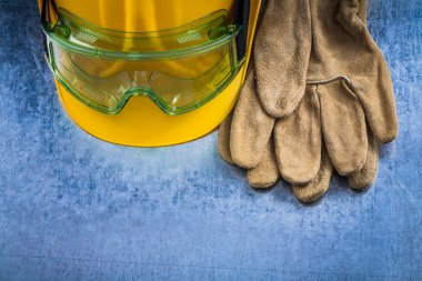 leather gloves, hard hat and glasses