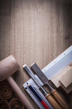 Wooden studs, mallet, firmer chisels