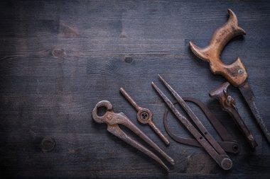 vinatge rusted tools on dark board