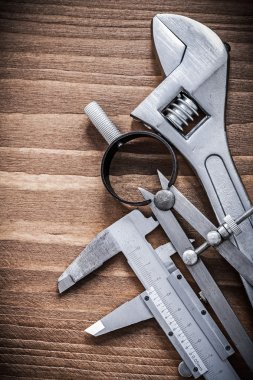 pair of compasses and adjustable wrench