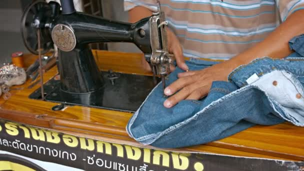 BANGKOK THAILAND CIRCA FEB 40 Local Worker Altering Jeans On Inspiration Sewing Machine Thailand