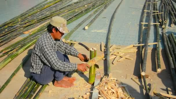 INLE LAKE. MYANMAR - CIRCA JAN 2014: Local craftsmen working with bamboo wood