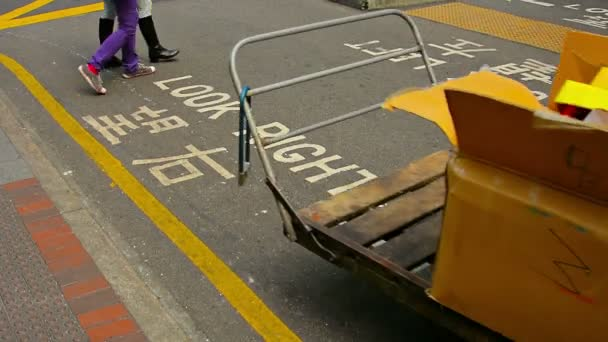 HONG KONG. CHINA - CIRCA JAN 2015: Caution sign. painted on a busy city street. warns pedestrians to look out for oncoming traffic in downtown Hong Kong.