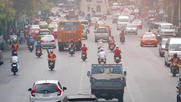 BANGKOK. THAILAND - CIRCA FEB 2015: Heavy Downtown Traffic in Bankok. Thailand. in Timelapse