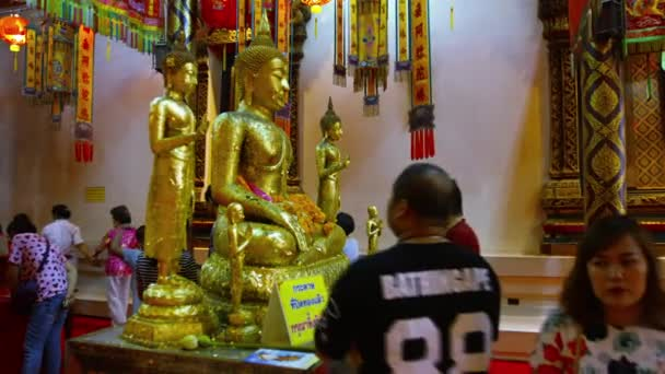 AYUTHAYA. THAILAND - CIRCA FEB 2015: Buddhists Giving Offerings to a Revered Buddha Statue at Wat Phanan Choeng in Ayutthaya. Thailand.