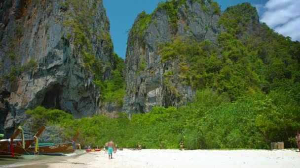 Jagged. towering. limestone crags. topped with sparse vegetation. overlooking the beautiful Railay Beach in Thailand.