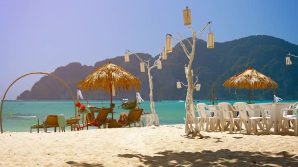 Tourists Lounging on a Tropical Beach under Natural Umbrellas