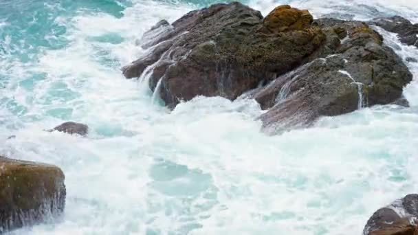 Ocean Waves Washing over Boulders on a Rocky. Tropical Beach