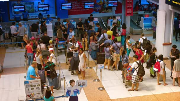 Passengers waiting in line at the Air Asia departure check-in counter