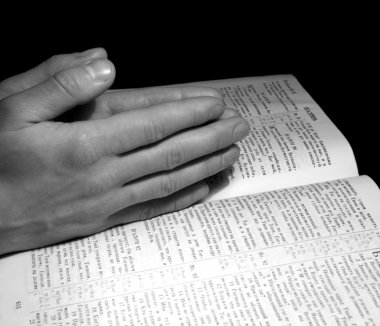 Man hands clasped in prayer