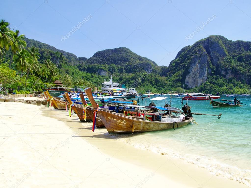 Tropical beach with  longtail boats
