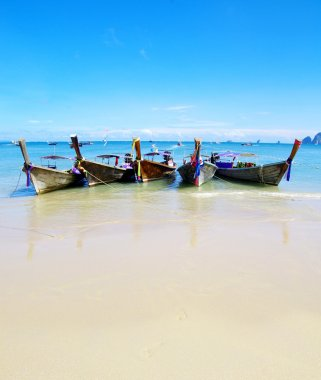 Tropical beach and longtail boats
