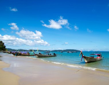 Tropical beach and  boats in Thailand