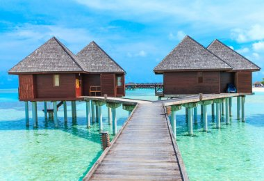 beach with water bungalows
