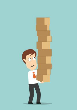 Businessman carrying a high stack of boxes