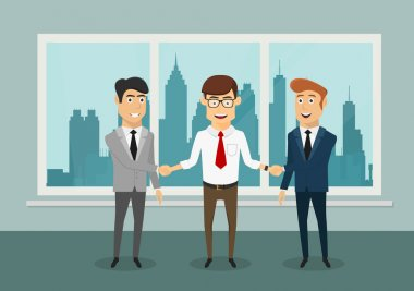 Businessmen shaking hands in modern office