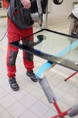 Applying adhesive sealant on windshield