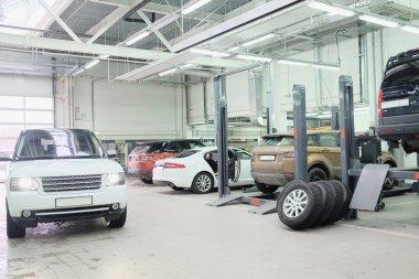Cars in a car-repair center