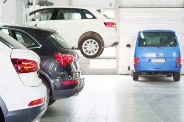 Cars in  dealer repair station in Moscow