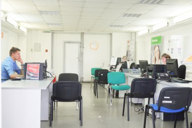 client office in a second-hand cars dealer showroom