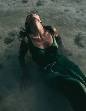 Woman bathing in the sea