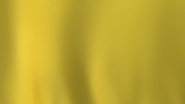 lassú hullámzó sárga üres szatén anyag közelkép