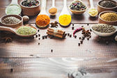 Fotografie Colorful spices in wooden spoons