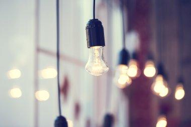 light bulbs hanging at window