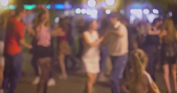 Kizomba, bachata or salsa. A lot of couples dancing social dance on open air party.