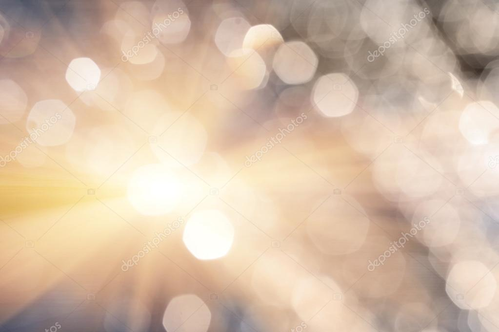 Shiny romantic bokeh. Defocused spots of water drops and lens flare or flash