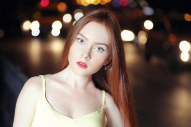 Redhead model in night city.