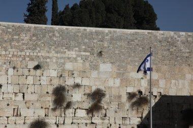 Israel flag and Wailing Wall in Jerusalem