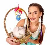Fotografie Frau im Stil der Ostern Eier und Leben Kaninchen halten