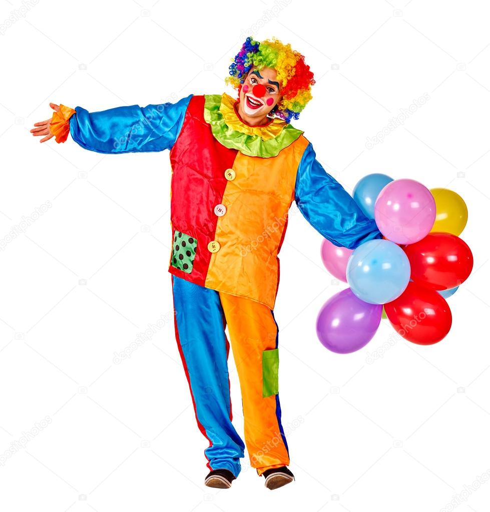 Happy birthday clown holding a bunch of balloons.